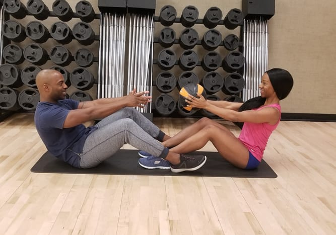 Try medicine ball sit ups with your workout partner